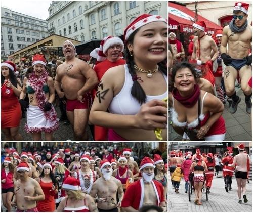 <strong>속옷만 걸친 산타들</strong> (EPA=연합뉴스)<br> 12월 9일 헝가리 부다페스트에서 열린 제15회 자선단체 돕기 산타클로스 달리기 대회에서 속옷만 걸친 참가자들이 경주하고 있다.