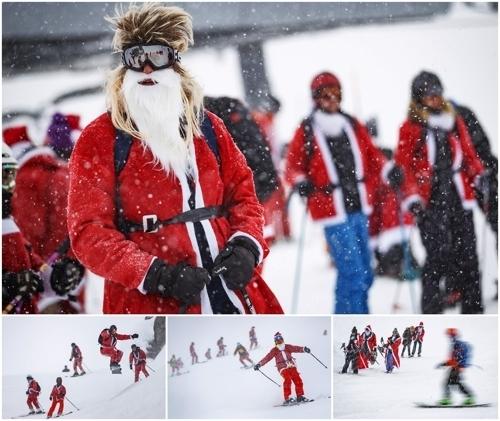 <strong>설산에서 스키 타는 산타들</strong> (EPA=연합뉴스)<br> 12월 8일 스위스 베르비에 알파인 스키 리조트에서 산타클로스 복장의 시민들이 스키를 즐기고 있다. 이날 스키 시즌 개장 프로모션 행사로 산타클로스와 성 니콜라스 복장을 한 3,015명의 스키어와 스노우 보더들이 티켓 값을 할인받았다.
