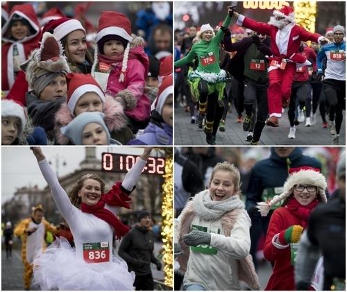 <strong>웃음이 넘치는 산타들</strong> (AP=연합뉴스)<br> 2018년 12월 16일 리투아니아에서 열린 크리스마스 달리기대회에서 산타클로스 복장의 시민들이 밝은 표정으로 달리기를 하고 있다.